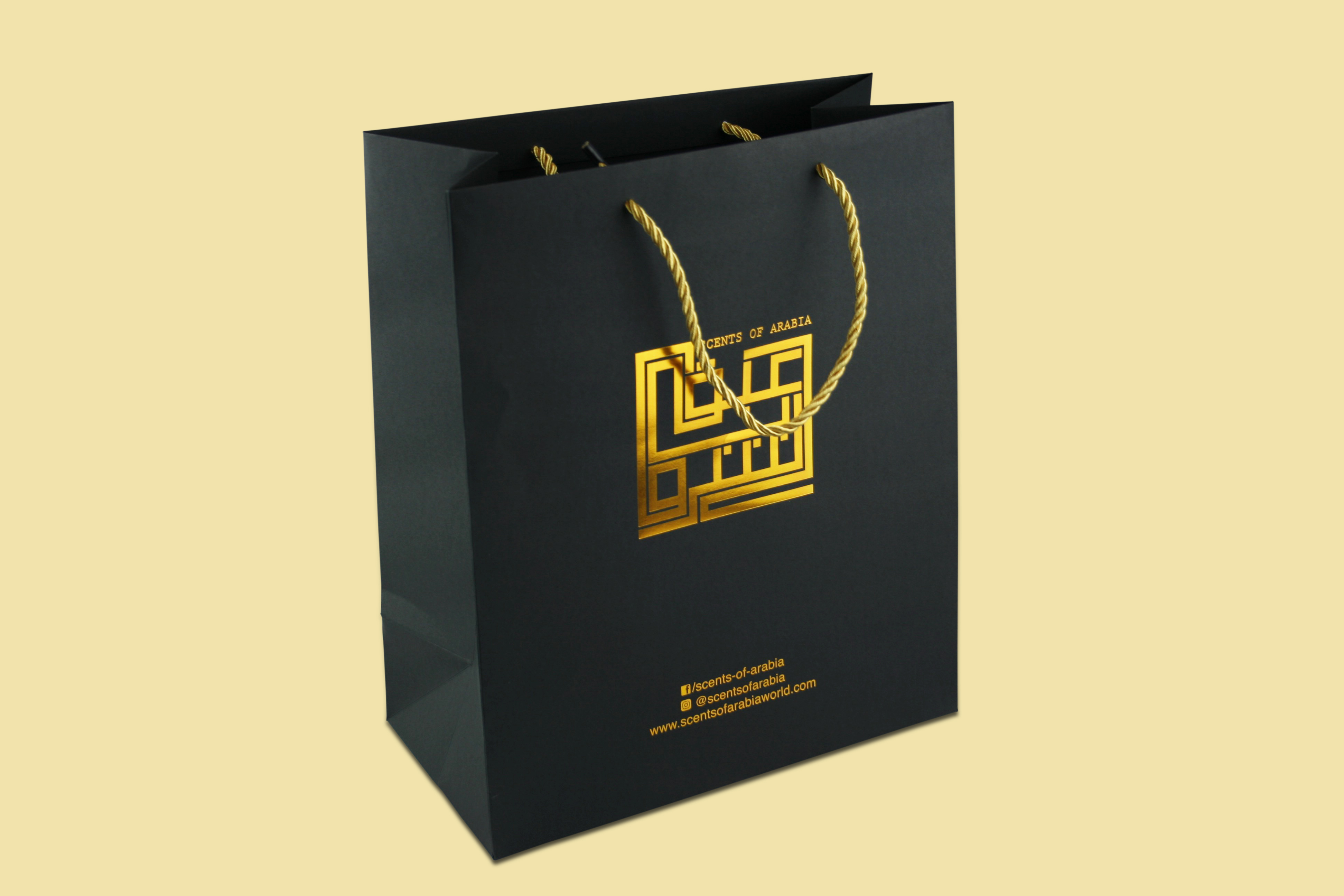 Black Special Paper Bag With a Rope and Gold Foiling.